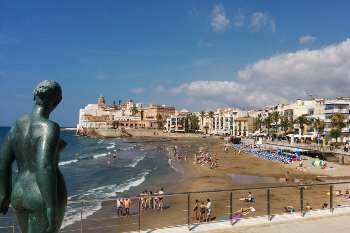 view of Sant Sebastià beach, located in the center of Sitges.